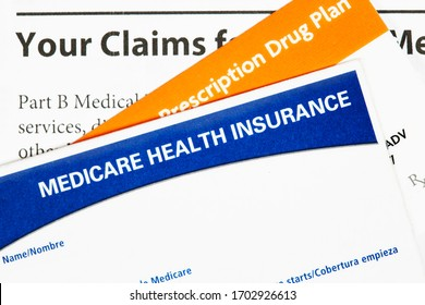 Medicare health insurance card with Prescription Drug Plan Card and claims statement isolated on white
