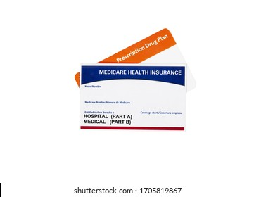 Medicare health insurance card with a prescription drug card isolated on white