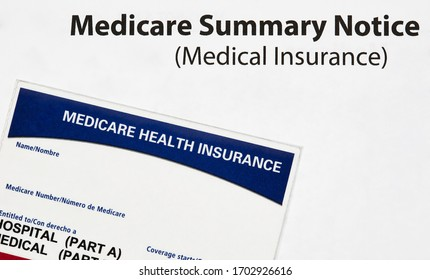 Medicare health insurance card with Summary Notice isolated on white