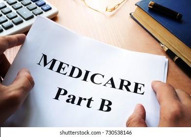 Medicare Part B on a desk.