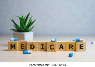 MEDICARE word made with building blocks, medical concept background.