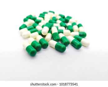 Medication and healthcare concept. Many white-green capsules of Tramadol 50 mg., it is a narcotic-like pain reliever. Used to treat moderate to severe pain. Isolated on white background and copy space