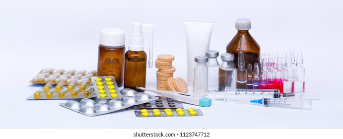 Medicinal and cosmetic preparations tablets ampoule jars of vaccines, syringes tonometer isolated on white background, both the concept of medicine and treatment of injections hospital and treatment