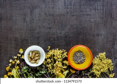 Medicinal and Healing herbs for clean eating biohackers paleo diet on vintage background flat-lay, top view.