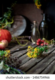 Medicinal herbs. Bunch of  St. John's wort lies on an old wooden table, rustic.