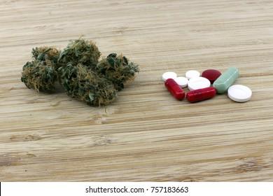 Medicinal marijuana buds against chemical pills