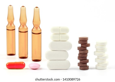 medicinal tablets and capsules on white background. pharmacology, medicine and treatment of diseases