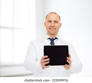 medicine, advertisement and workplace concept - smiling male doctor showing tablet pc computer screen over white room background