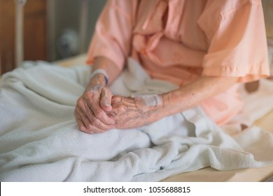 medicine, age, health care and people concept - older woman patient lying in bed at hospital ward.