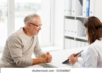 medicine, age, health care and people concept - senior man and doctor with tablet pc computer meeting in medical office at hospital
