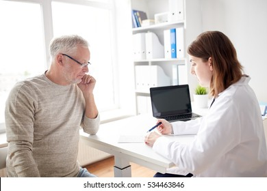 medicine, age, health care and people concept - senior man and doctor with prescription meeting in medical office at hospital