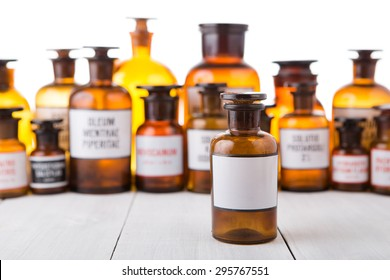 medicine bottle with blank label on wooden table