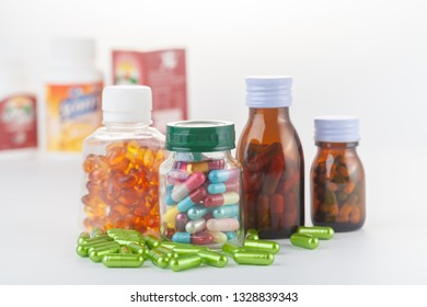 medicine bottle with capsule on white background.