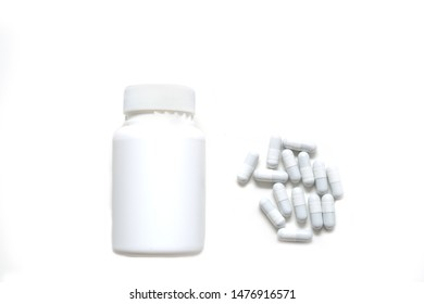 Medicine and medicine bottle on white background.