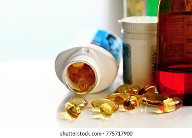 medicine bottles with capsules laying on the table