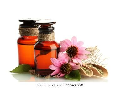 medicine bottles with purple echinacea , isolated on white