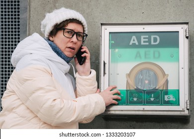 medicine cardiopulmonary resuscitation emergency call. Caucasian woman uses telephone calling 911 help. device box aed automatic defibrillator diseases.