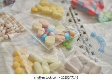 Medicine in clear plastic bag on notebook background.