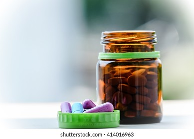 Medicine concept : Pills spilling out of pill bottle