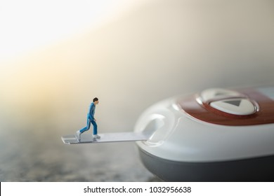 Medicine, diabetes, glycemia, health care and people concept - close up of runner miniature figure running on blood sugar test strip and connect to Glucose meter