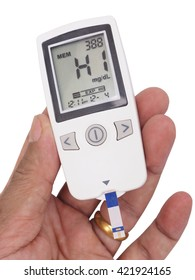 medicine, diabetes, glycemia, health care and people concept - close up of checking blood sugar level by glucometer and test stripe at home show data at HIGH blood sugar level
