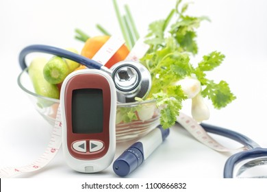Medicine, diabetes, health care concept. Close up of Glucose meter for check blood sugar level with lancet, Stethoscope, tape measure and green vegetable fresh tomato, cucumber coriander and scallion.