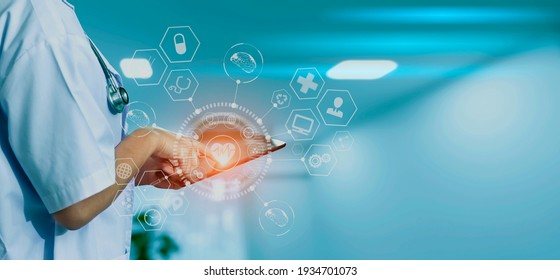 Medicine doctor and analysis technology network connection concept. Doctor hands using digital tablet and medical interface icons at hospital blurred background.