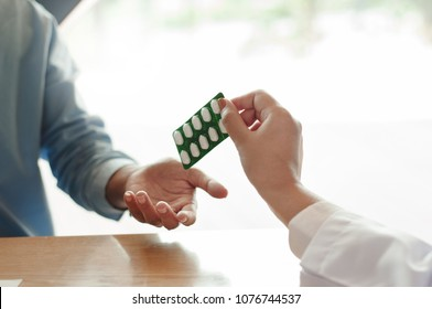 medicine doctor giving a blister of pill to patient
