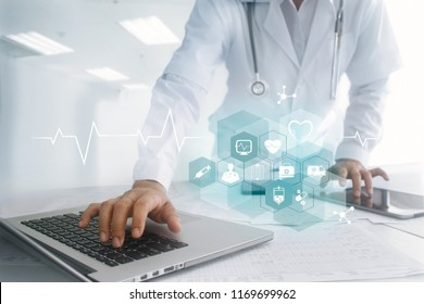 Medicine doctor hand touching laptop and tablet interface as medical network connection with icon modern on virtual screen, Digital healthcare, medical technology network and innovation concept