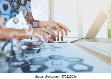 Medicine doctor hand working with modern computer with digital health care diagram on wooden desk as medical concept