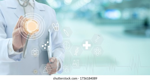 Medicine Doctor holding stethoscope with healthcare and medical icon with hospital background. medical technology concept. wide view.