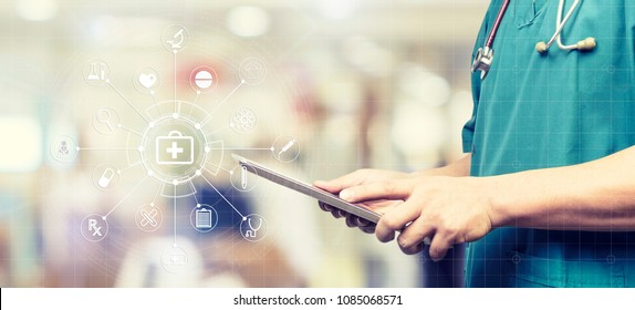 Medicine doctor or medical students with stethoscope using digital tablet laptop,Health Check with digital system support for patient with medical icon at hospital, Medical network technology concept.