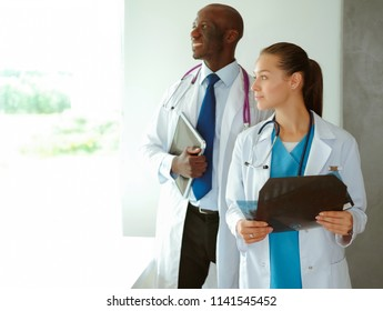 Medicine doctor offering hand to shake in office closeup. Doctors