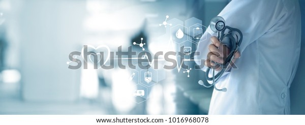 Medicine doctor with stethoscope in hand and icon medical network connection on  virtual screen interface. Modern medical technology and innovation concept