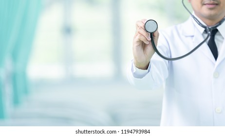 Medicine doctor and stethoscope in hand touching icon medical network connection with modern virtual screen interface, medical technology network concept