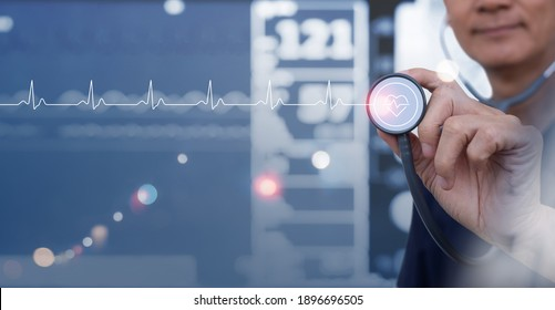 Medicine doctor with stethoscope touching EKG heartbeat graph on virtual screen interface, monitoring vital signs monitor as background, cardiologist examining in hospital, medical technology concept