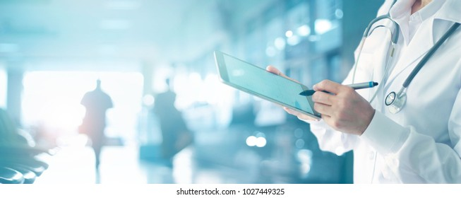 Medicine doctor and stethoscope touching medical information network connection interface on digital tablet in hospital background. Medical data and technology network concept