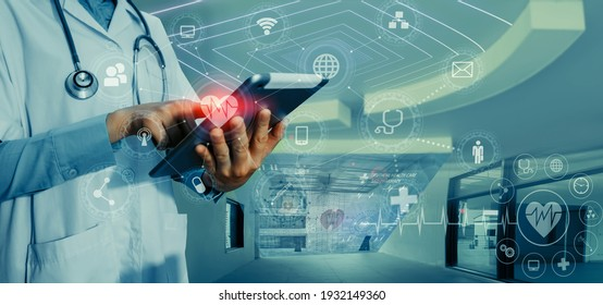 Medicine doctor touching on tablet and digital healthcare and network connection with modern virtual screen interface icons on the hospital background, Medical technology and network concept.