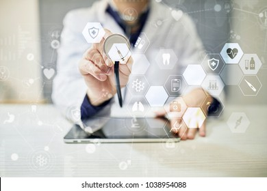 Medicine doctor is using modern computer virtual screen interface, medical technology network concept. EHP, EMR, Electronic health record.