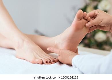 medicine flatfoot hands massaging foot