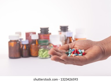 medicine in hand on white background.