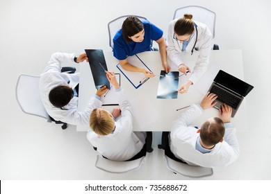 medicine, healthcare and people concept - group of doctors discussing x-rays on conference at hospital