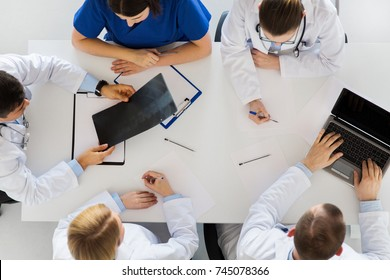 medicine, healthcare and people concept - group of doctors discussing spine x-ray on conference at hospital