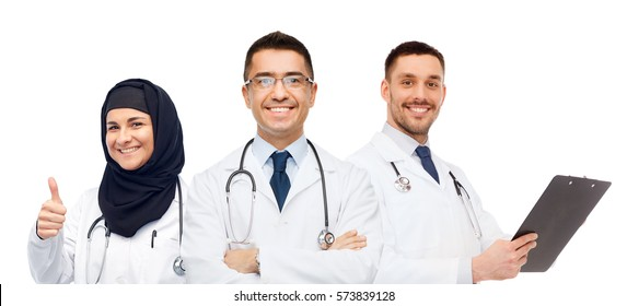 medicine, healthcare and people concept - happy smiling doctors in white coats with stethoscopes and clipboard showing thumbs up