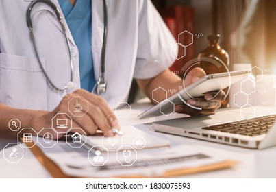 Medicine, healthcare and people concept - male doctor with stethoscope and clipboard at clinic