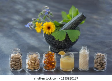 Medicine, Healthcare, Pharmaceuticals, Food supplements and homeopathy,capsules on slate background