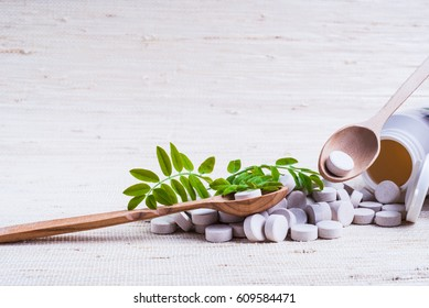 Medicine herb. Herbal pills with healthy medical plant. Green leaf, alternative drug. Natural pharmaceutical capsule. Vitamin supplement for care, medication, treatment.