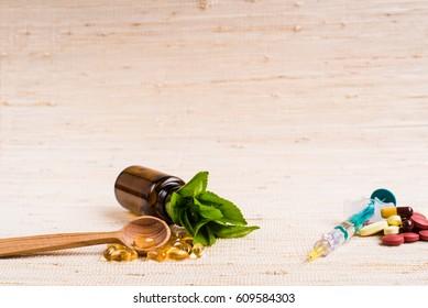Medicine herb. Herbal pills, syringe, injection with healthy medical plant. Green leaf, alternative drug. Natural pharmaceutical capsule. Vitamin supplement for care, medication