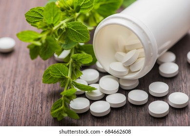 medicine herbal pills with bottle on background. alternative organic pharmacy
