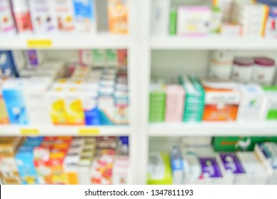 Medicine on shelves in Pharmacy interior with blurred background